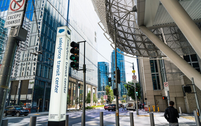 Salesforce transit center sign on a busy street in the financial sector