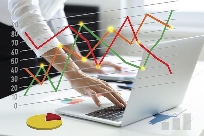 Woman using laptop analyzing sales data
